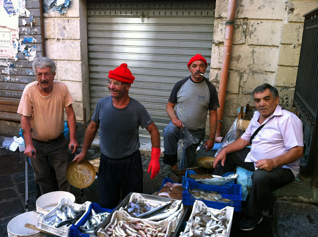 Men Selling Fish - Sicily + the Aeolians: The Island of Salina - Peggy Markel's Culinary Adventures